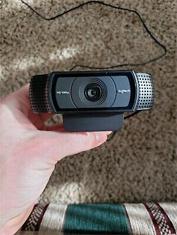holding the logitech c922 pro stream webcam